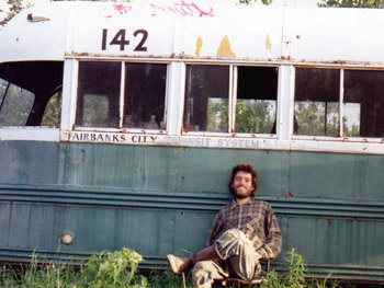 The last known photograph of Christopher McCandless, in front of his Volkswagen bus in Alaska.