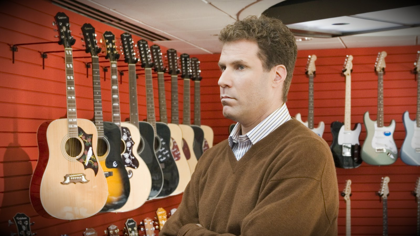 "Will Ferrell as Harold Crick in the Sony Pictures movie ""Stranger Than Fiction"" looks at a room full of guitars."
