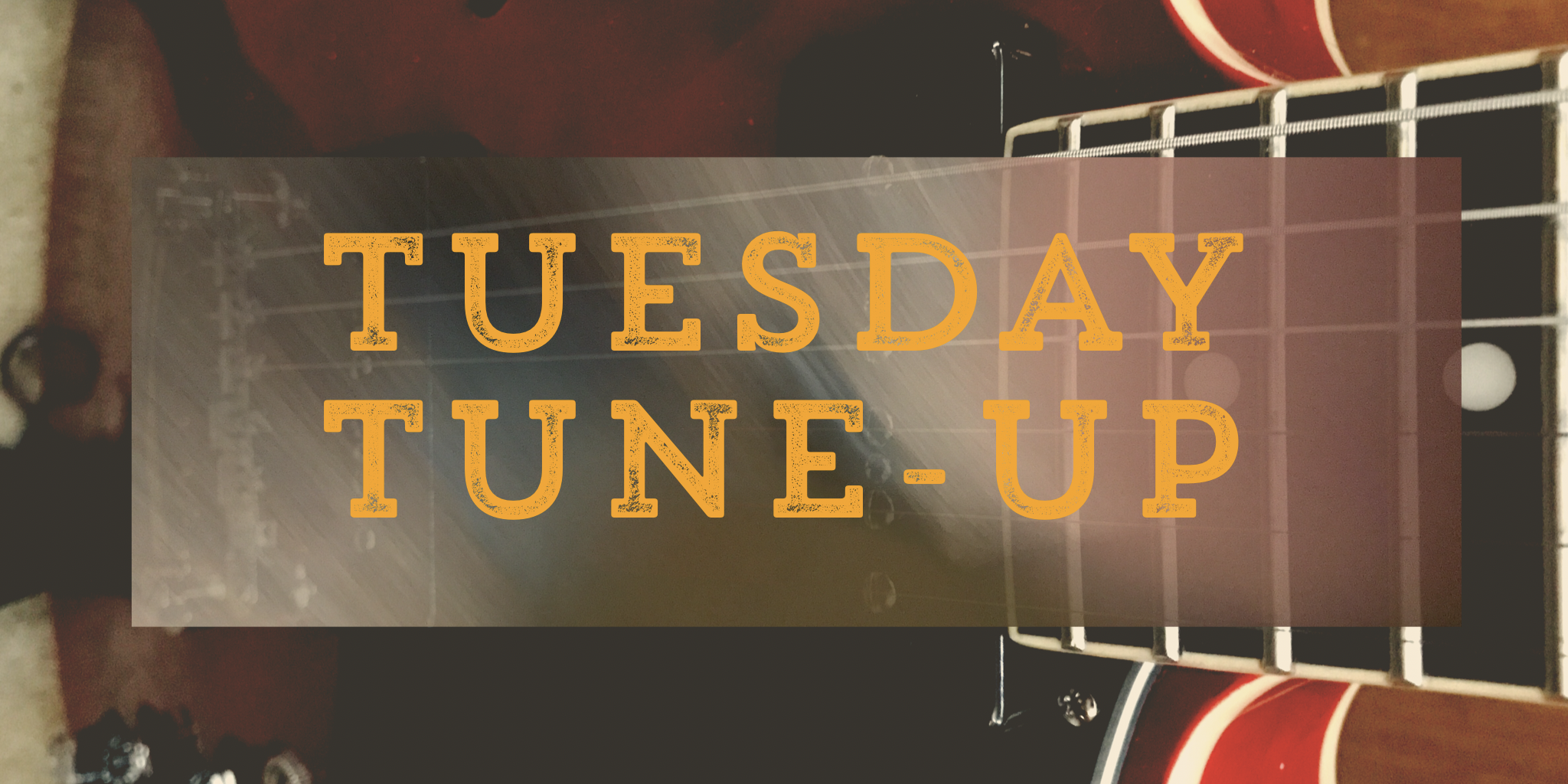 Brandonia Tuesday Tune-Up logo - a red electric guitar with the words Tuesday Tune-Up imposed over the top.