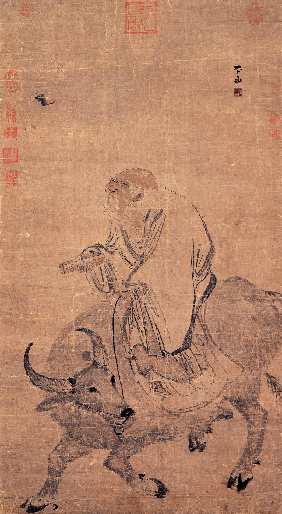 Ancient Chinese scroll of an elderly man riding an ox.