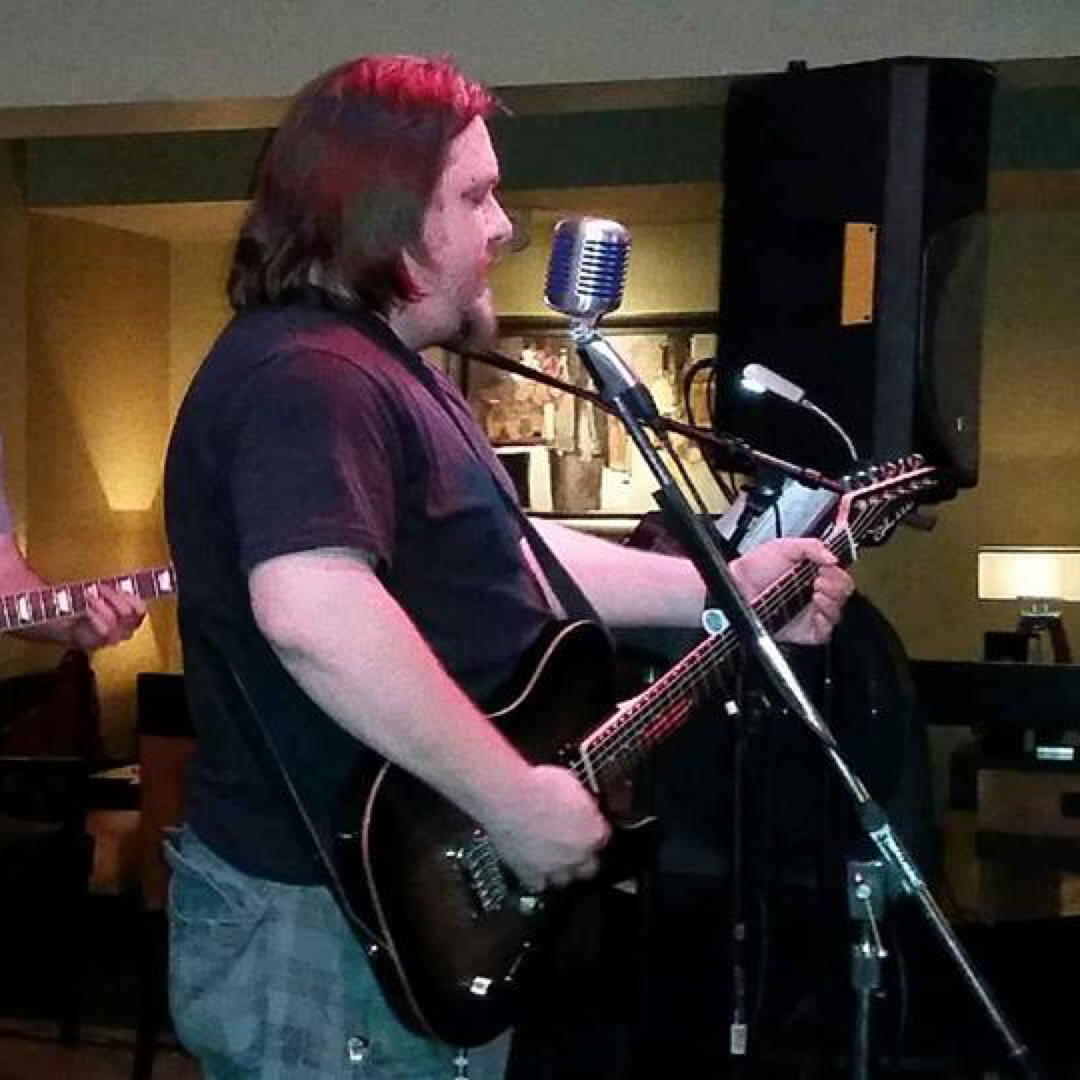 Photograph of me playing guitar with the band Mojo Box circa 2015.  I weighed around 250 pounds back then.