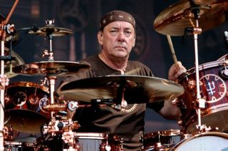 Image of Neil Peart behind a drum kit.