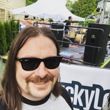 Selfie of me standing side stage in the beer garden area of the Cannonball Festival.